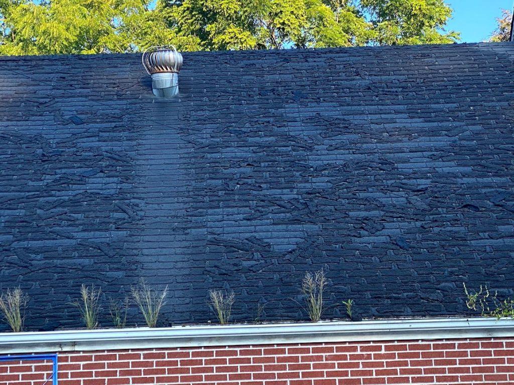 asphalt roof that needs replacing
